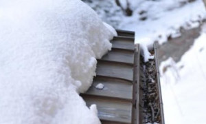 Prevent snow melt from refreezing on roof edge using heat tape and heat cable, HotEdge Rail Roof Ice Melt System